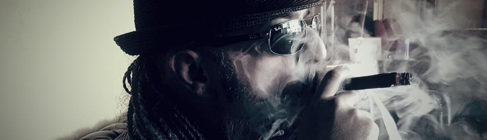 Oz G. Smoking a Cigar